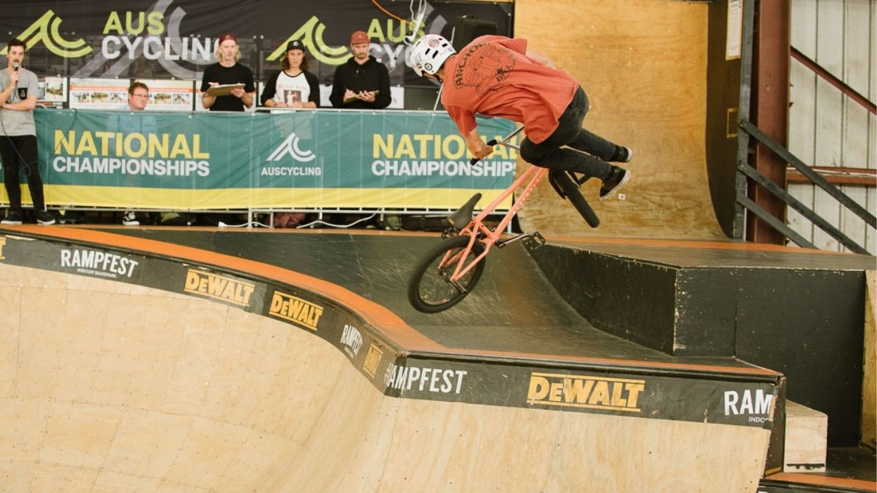 Intermediate BMX Rider doing a tailwhip air at Rampfest indoor skate park in melbourne