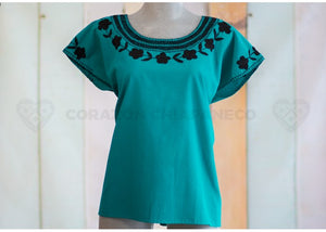 MANTA PITCH IN TURQUOISE BLOUSE