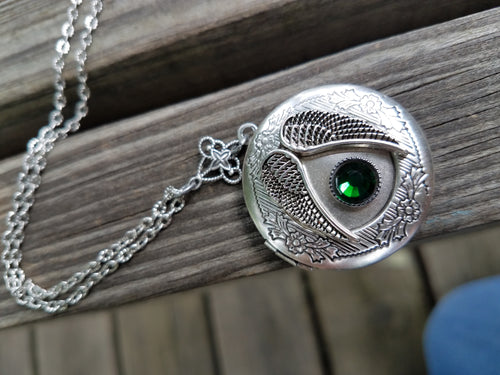 Angel locket with birthstone.