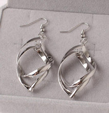 Earrings.  Silver Drop Leaves, Pendant Earrings Twisted, Long Danglinag - Songbird Deals