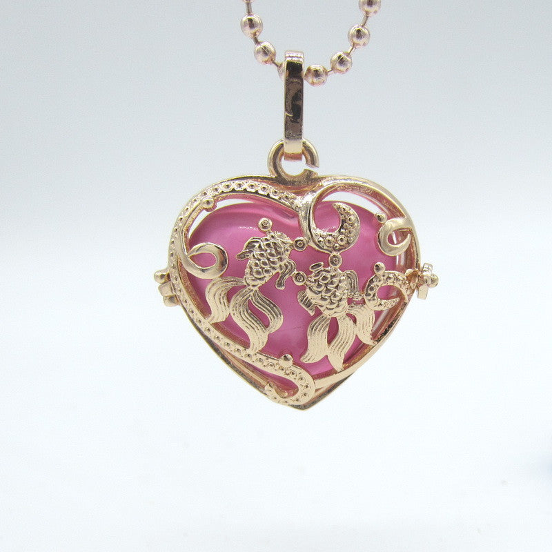 Pendant. Golden Fishes Hollowed Heart Shaped Locket - Songbird Deals