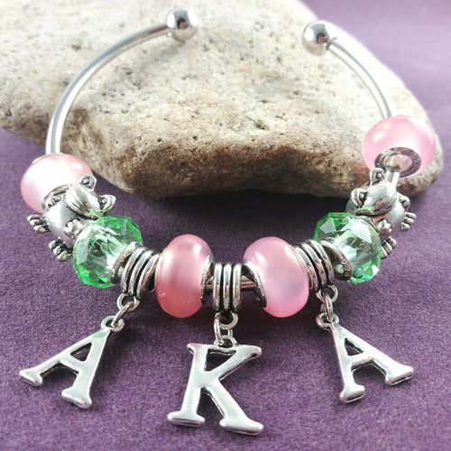 Bracelet. AKA  pink and green 'Divine 9'   Bead  AKA frog Charm Bangle sorority BGLO - Songbird Deals