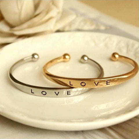 Gold, Platinum, and Rose Love Bracelets