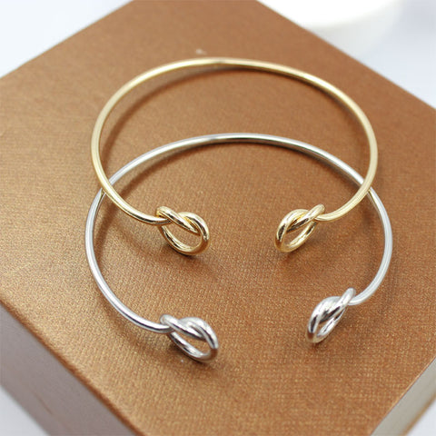 Gold, Black, and Silver Double Knot Bracelet