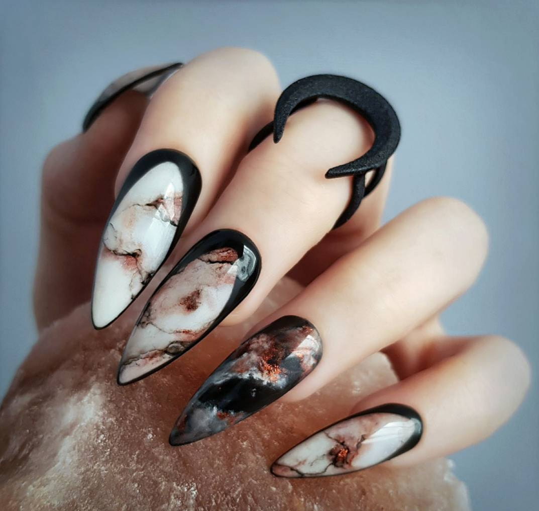 Warm toned acrylic marble with black accents