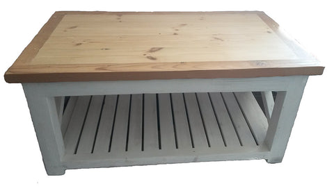 Wooden coffee table made from reclaimed, re-purposed timber. The table has a beautiful raw wooden top with modern white washed base and shelf with extra storage. Handmade in Cape Town by Rustic Wood