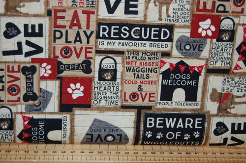 fabric shack sewing quilting sew fat quarter cotton quilt patchwork dressmaking clothworks dan di paolo wigglebutts paw prints black labrador puppy dog block love