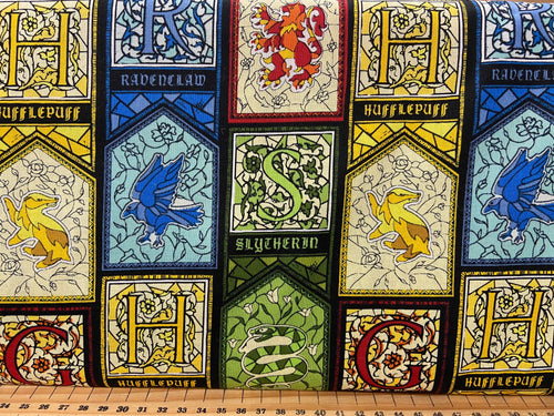 fabric shack sewing quilting sew fat quarter cotton patchwork quilt harry potter stained glass houses slytherin hufflepuff gryfindor gryffindor ravenclaw spell wizard