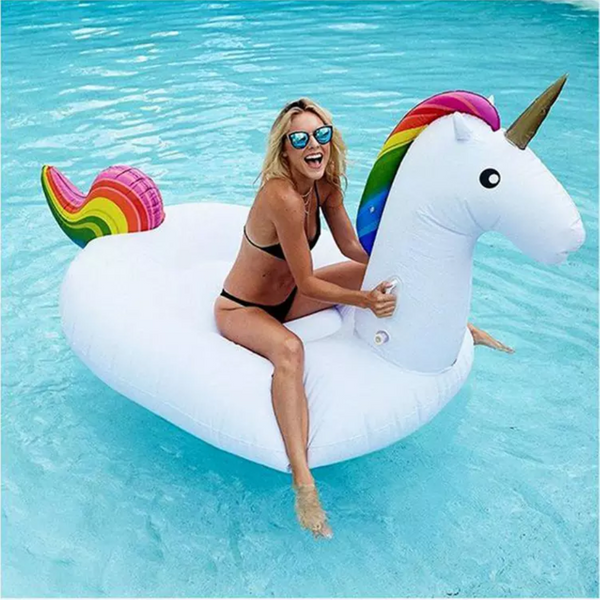 Inflatable Unicorn Pool Toy with Girl wearing Glasses in Pool