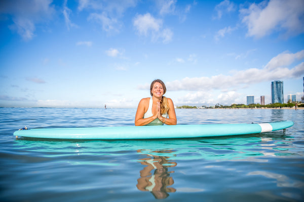 sup yoga in the ocean