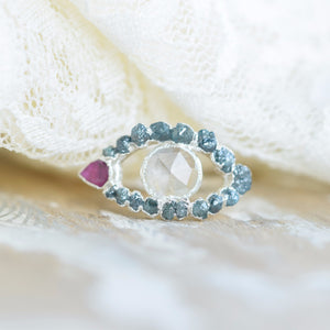 RAW BLUE DIAMOND, MOONSTONE AND RUBY EYE RING IN FINE SILVER