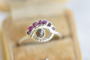 RUBY AND DIAMOND EYE RING/'LOOKING RING' IN FINE SILVER