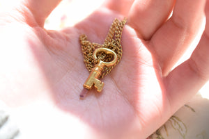 ANTIQUE KEY PENDANT WITH PINK TOURMALINE IN GOLD