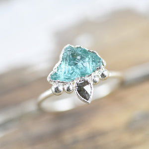 RAW EMERALD 'MOUNTINS GREEN' RING WITH ROSE CUT BROWN DIAMOND IN FINE SILVER