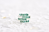GRADUATED RAW MULTI STONE EMERALD RING IN FINE SILVER