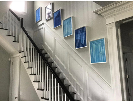 Stairway with artwork Blue and white Prints Hamptons Style