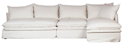 White sectional sofa slip covered in heavy cotton Feather fillings