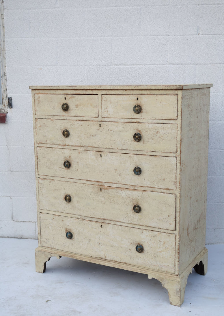 old pine dresser with shabby chic feel, old ivory paint, brass pulls