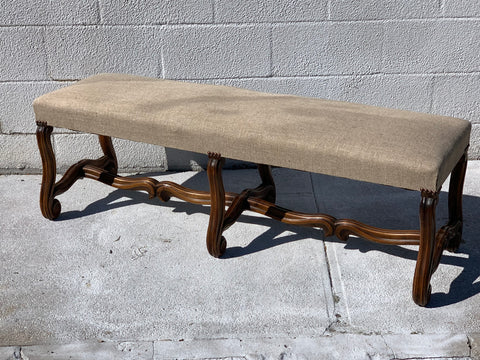 Upholstered Bench with walnut,  Ous Du Mouton style base and stretcher, with heavy linen upholstery
