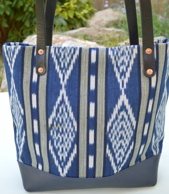 Ikat fabric tote bag with a navy leather base and black leather straps
