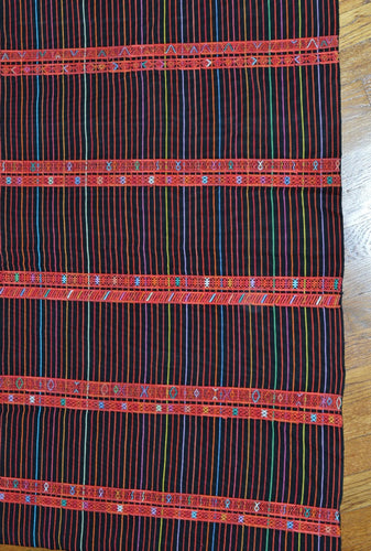 A vintage Aguacatan corte from Guatemala in black, red and small alternating stripes