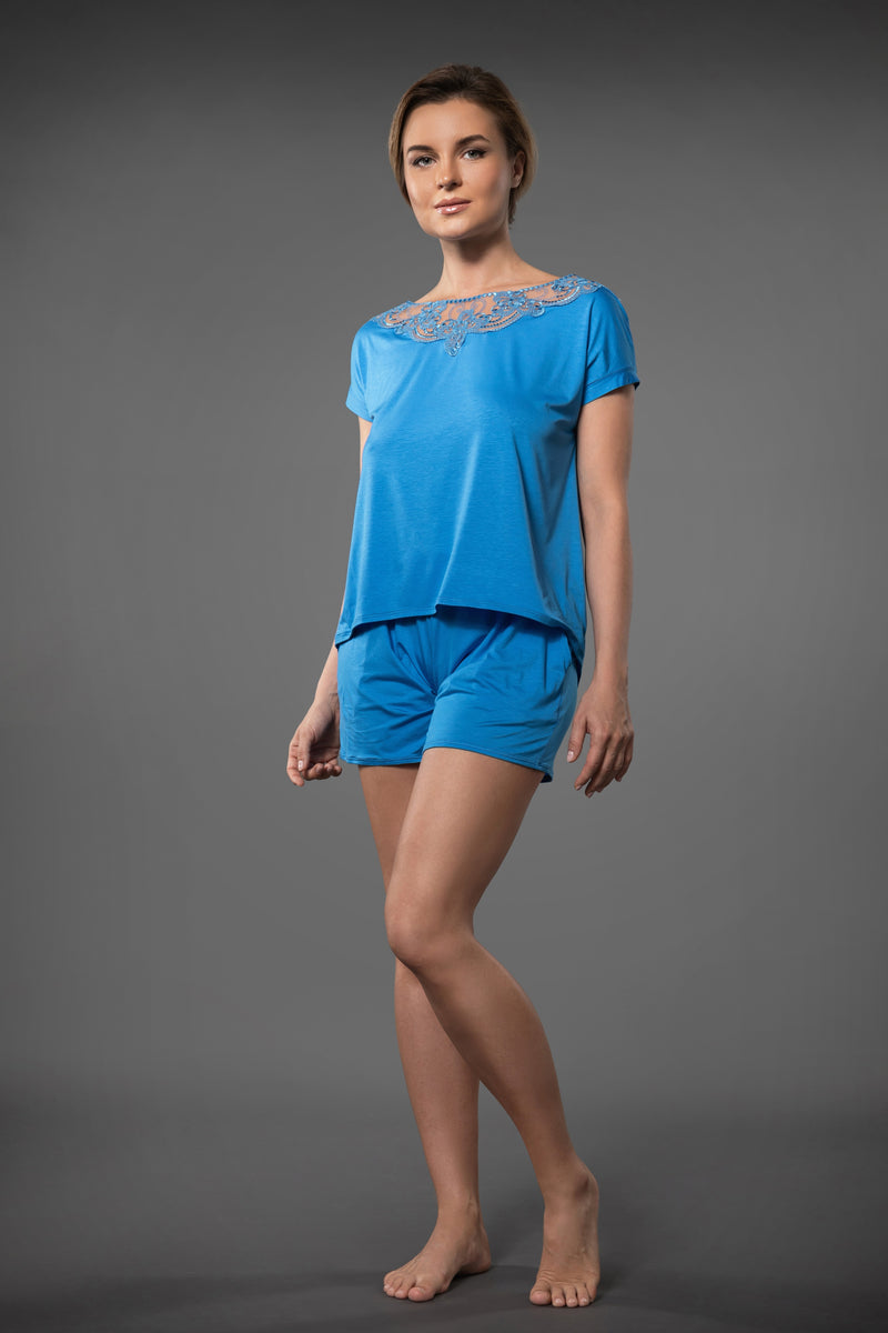 Summery light blue ladies pajama sets short sleeve embroidered top and light pajama shorts with pockets