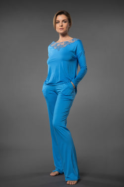 Plus size light blue pyjama sets top with embroidered neckline and blue pajama bottoms with pockets