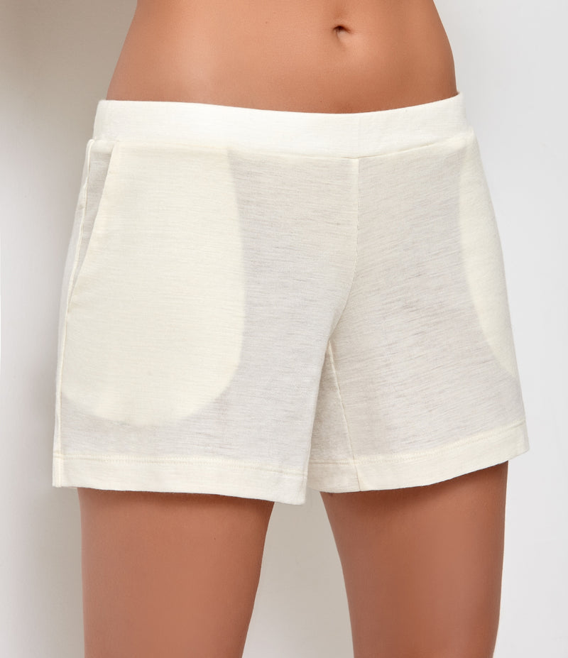 White pajama shorts with side pockets, these pajama bottoms are made of merino wool and silk blend