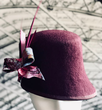 St Pancras - Mulberry Cloche with Abstract Bow and Feather Trimmings