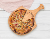 Homemade pizza on Frederica Trading bamboo pizza peel paddle board