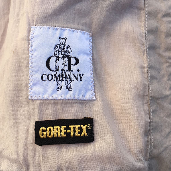 cp company and gore tex logos