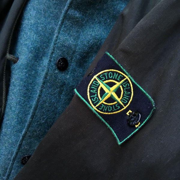 green edged stone island badge on raso gommato jacket