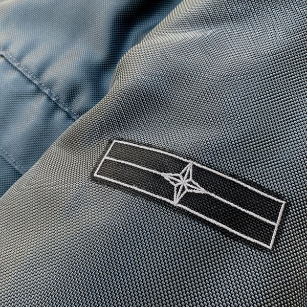 stone island denims compass logo on sleeve