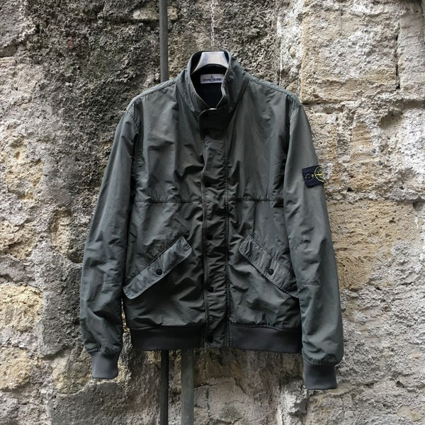 stone island ss 2013 micro reps bomber jacket in olive hanging on wall