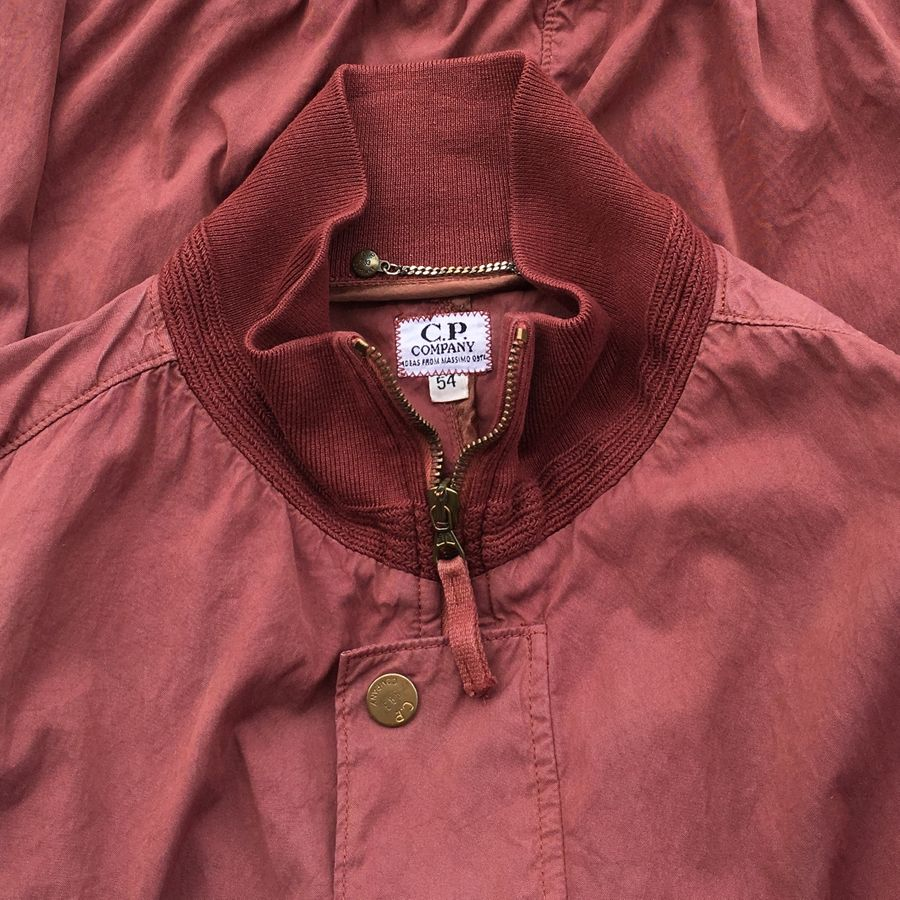 vintage c.p. company flight jacket in faded red. Designed by Massimo Osti for 1993 collection