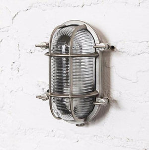 Barge wall light, cage light, glass and metal light, outside light. vintage wall light, industrial light, wholesale lighting nz, wholesale lights new zealand, bathroom lights, bathroom wall lights, outdoor lighting, industrial wall lights