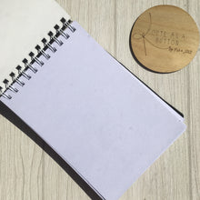 A5 sketch book  featuring handmad ankalia foundation dionysus wrap removable dust cover.