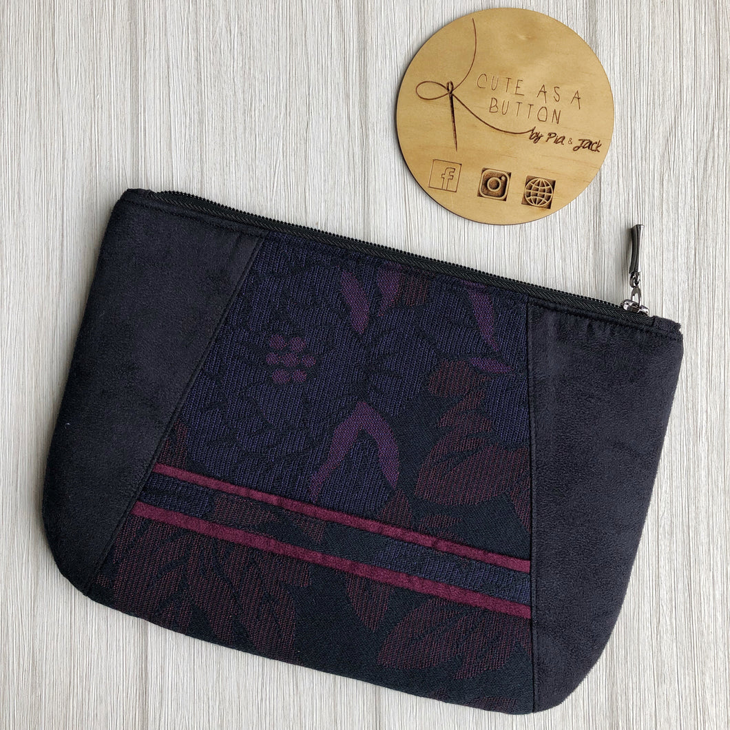 Black Clutch featuring Ankalia alchemy's bloom