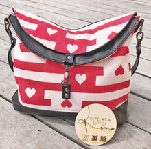 Hearts desire handbag featuring Aroha sweet heart wrap