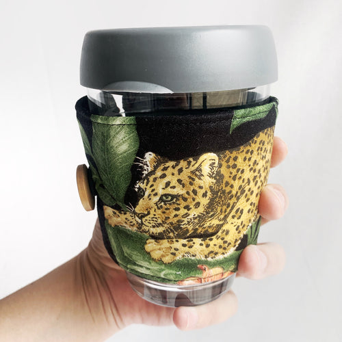Lounging leopard Keep cup cozy
