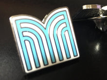 Materia Collective lapel pin