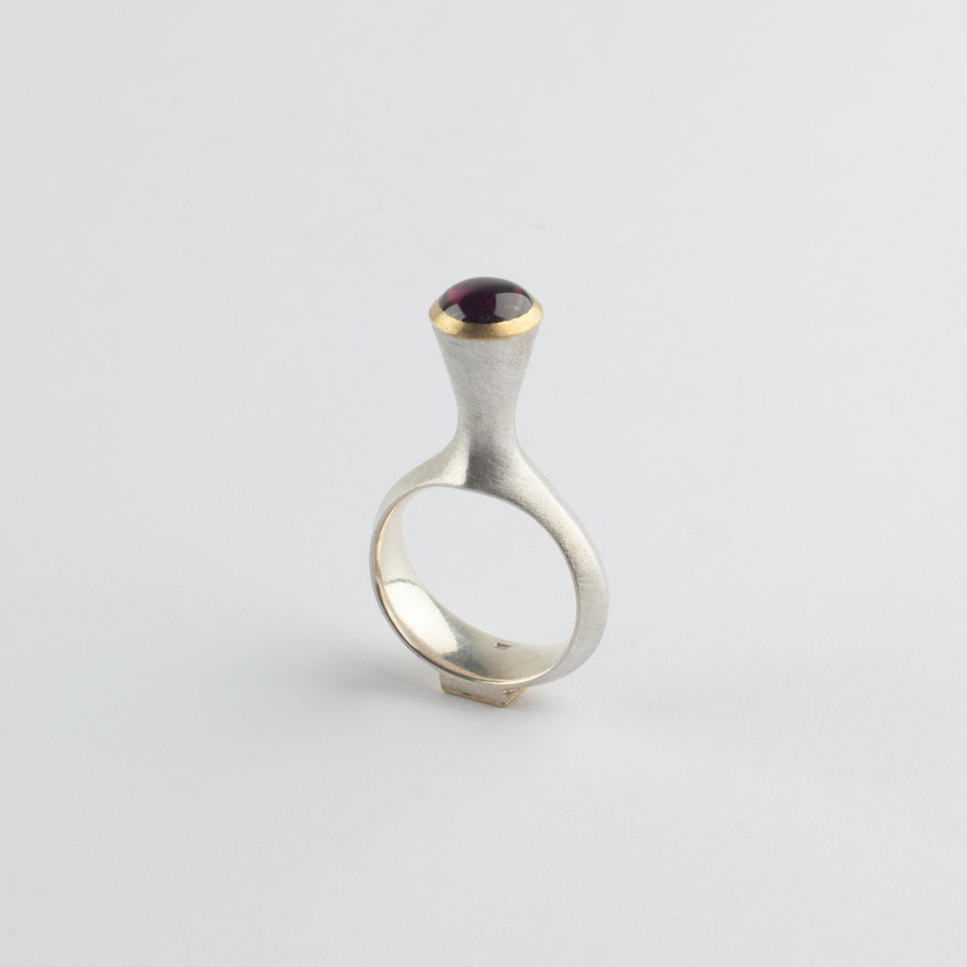 'Tower' ring with garnet