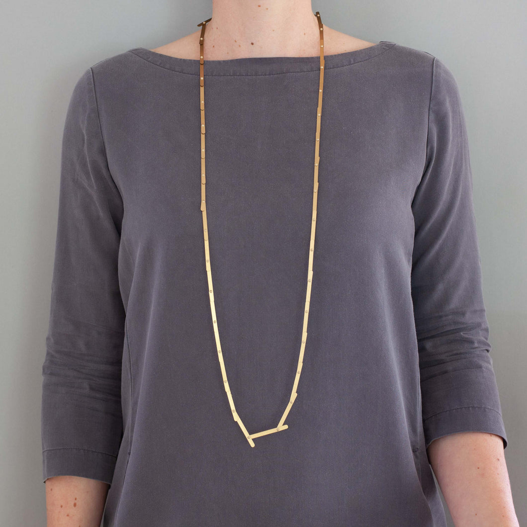 'Priceless' necklace - long gold