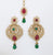 antique gold plating with a touch of red and green set with polki stones comes with matching chandbali earrings
