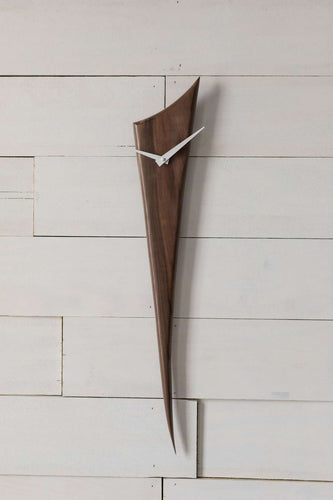 Black Walnut Stake Clock is made of one solid piece of rich Black Walnut. This clock is understated, yet demands attention simply because of the gorgeous wood. Pointed white metal hands create a nice contrast with the wood. At 29