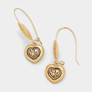 Filigree Heart Earrings. These beautiful rhodium gold-tone earrings will add a nice touch to your evening wardrobe.
