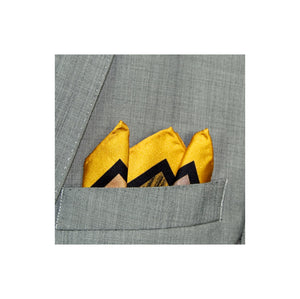 Yellow border silk pocket square with abstract pattern in black and grey shown in a grey suit