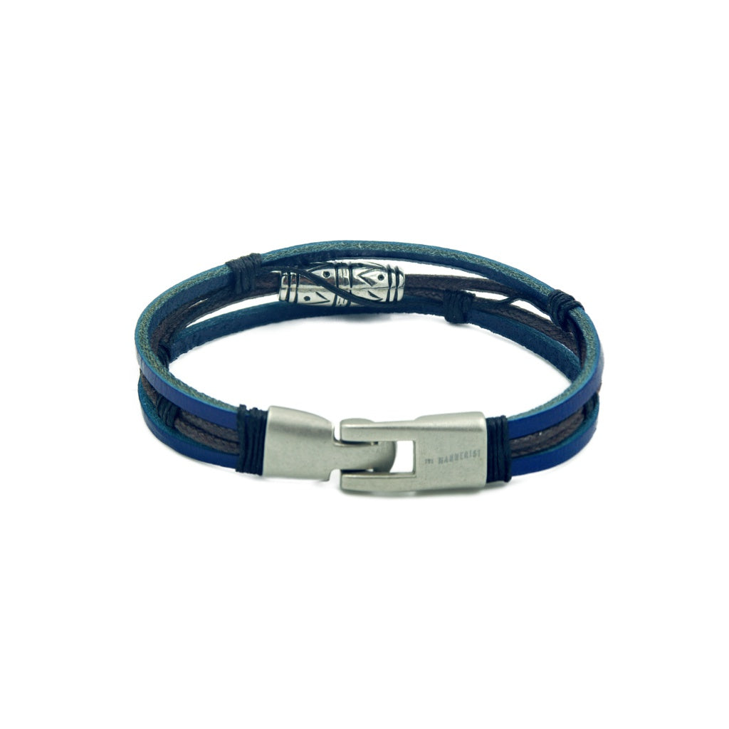 Three band men's leather bracelet with two blue leather bands outside and a patterned bead.
