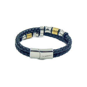 Men's leather bracelet with two black rope style bands and beading in silver and gold color.