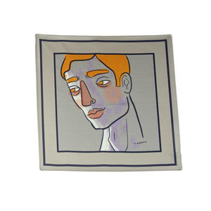 Grey silk pocket square with portrait design in yellow, black, white and hints of purple.